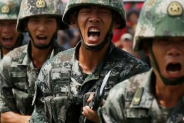 A bunch of Chinese soldiers grasping bayonets and shouting