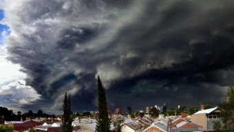 Dark, ominous clouds roll over suburban houses
