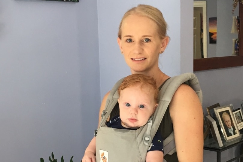 Kirsty McDonald with son Leni in a baby carrier