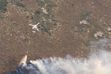 Water bombing helicopter attacks fire in Tasmania