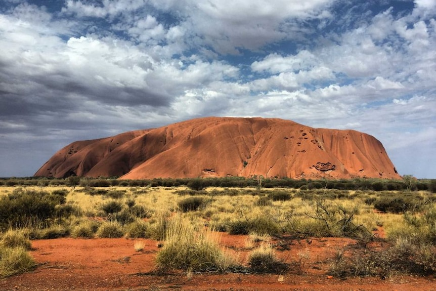 A photograph of Uluru during the day time.