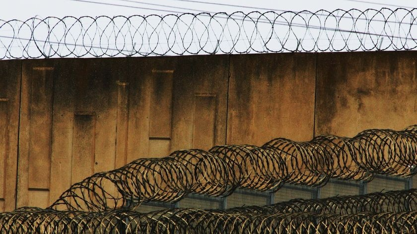 Caged: Prisoners serving short sentences will be able to vote after the High Court decision today