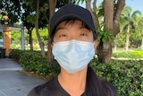 A woman wearing a surgical face mask