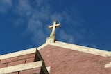 Cross on top of a church building.