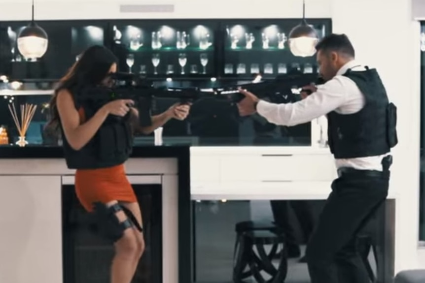 A still from an ad for a Queensland home in the style of the movie Mr and Mrs Smith.