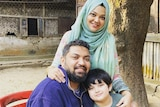 Hansanul Bunna Khan with his wife Tashfia and son Nayel pose for a picture by a tree