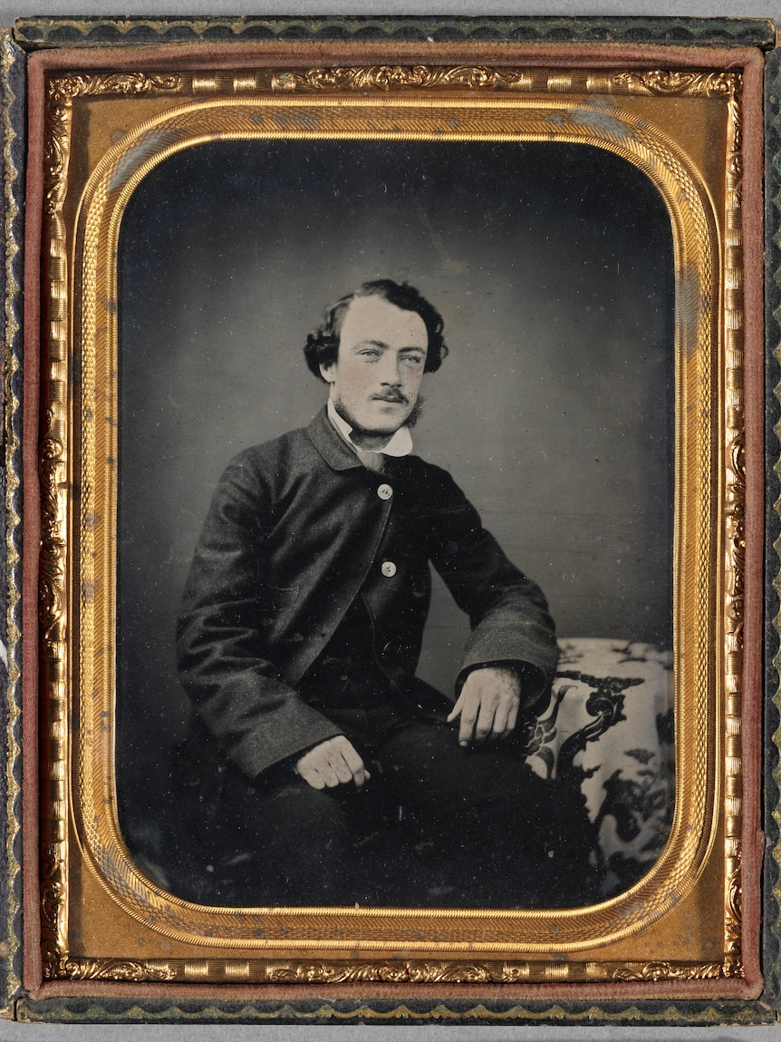 Thomas Wentworth Wills, c 1859, 1/2 plate ambrotype with applied colour in a double elliptical brass matt in a leather case (12.4 x 15.2 x 2.2 cm)