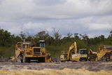 Earth moving vehicles at work on a construction site.