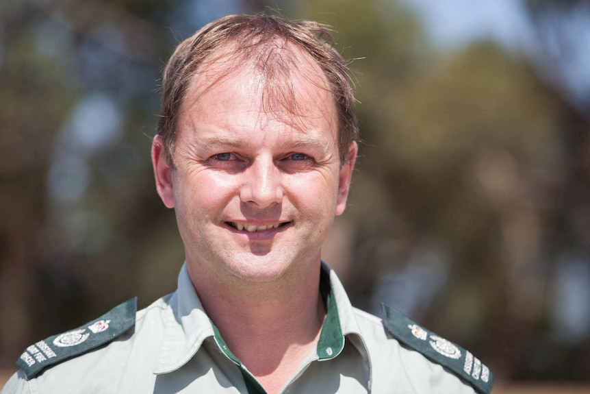 Chris Eagle, Chief Fire Officer for Forest Fire Management smiles as he looks at the camera
