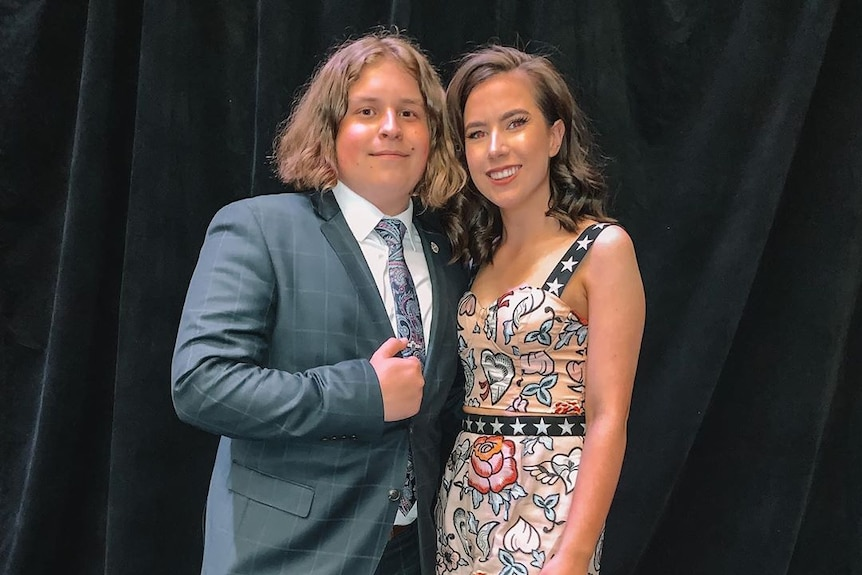 A young couple at a formal event.
