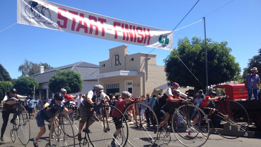 Penny farthing riders take off