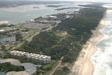 Aerial shot of Gold Coast spit, an inlet largely covered in trees.