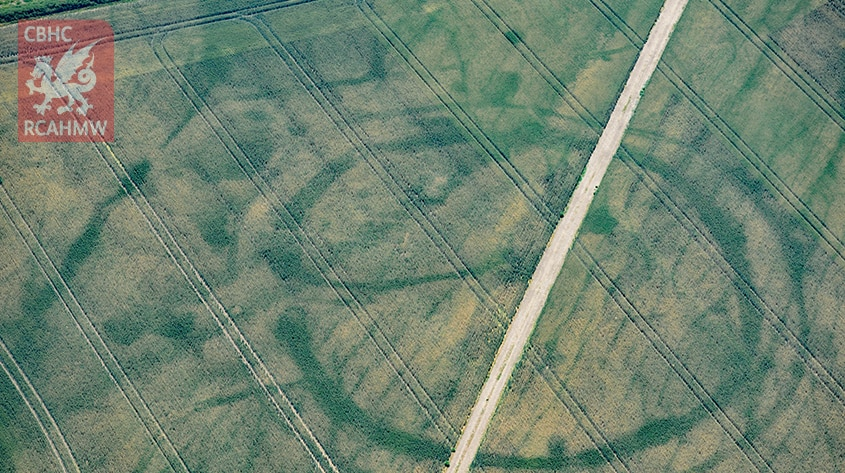 Cropmarks of a large prehistoric enclosure in the Vale of Glamorgan with the faint footings of a probable Roman villa within.