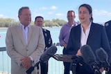 Andrew Forrest and Annastacia Palaszczuk stand together at a media conference in Gladstone.