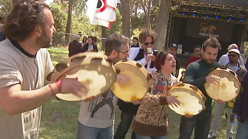 Dancers and musicians perform for the media at Womadelaide's opening ceremony.