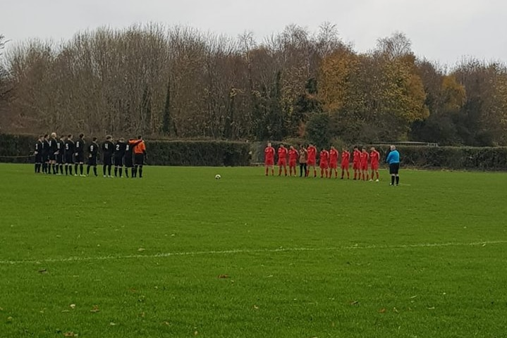 Liffey Wanderers players hold a minute's silence