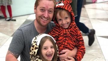 Jason Burland with his children, who are still in Brisbane.