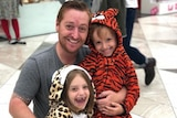 Jason Burland with his children, who are still in Brisbane.
