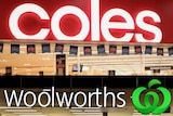 A composite image of a bright red and white sign that says 'coles' and a white sign that says 'woolworths' with a green icon.