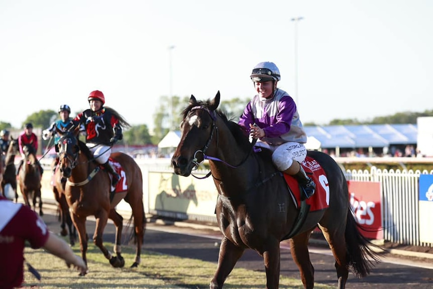 Jockey Jessie Philpot riding Highly Decorated just after their 2021 Darwin Cup win.