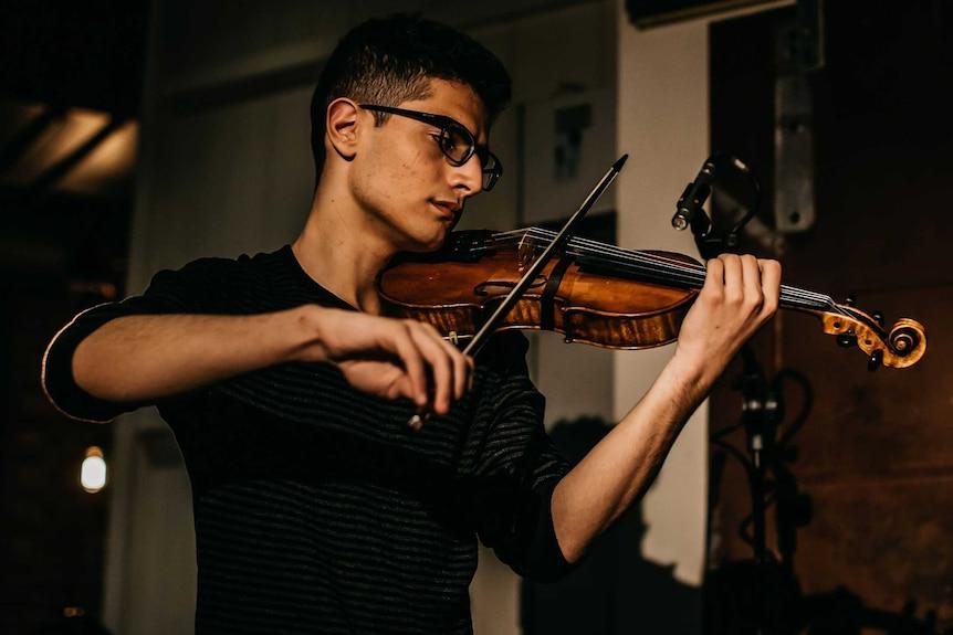 Aboud Kaplo playing his violin