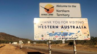 Sign at border between WA and NT