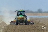 A tractor plows the ground in the Murray-Darling Basin