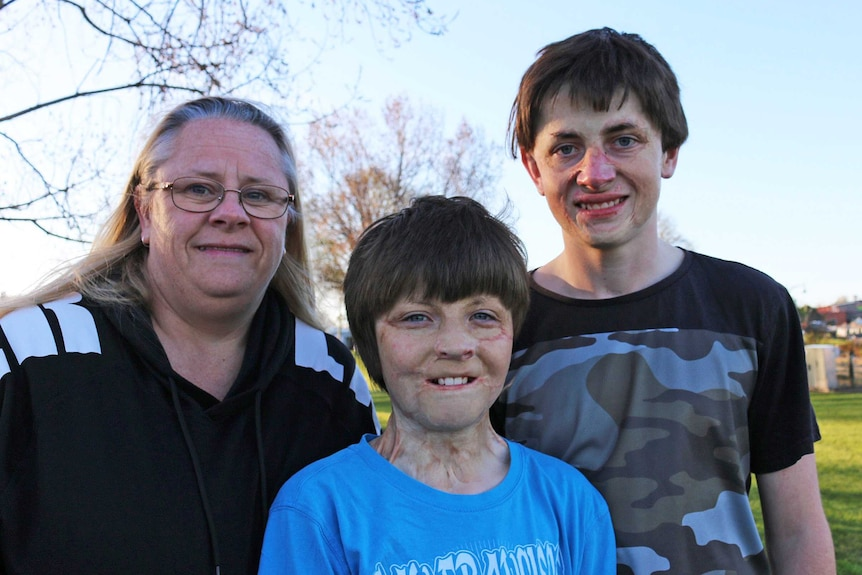 Alison McGee and her sons Spencer and Fletcher Connelly smile for the camera.