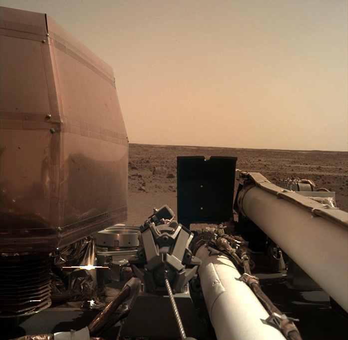 The InSight probe's second image, showing a desolate red plain.