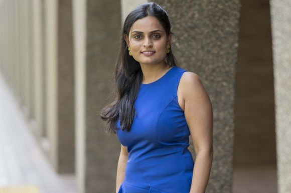 A woman in a blue dress.