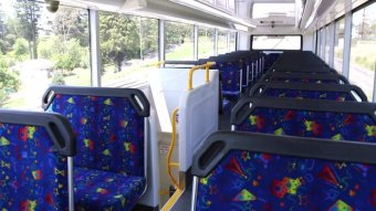Empty seats on the top deck of a bus.