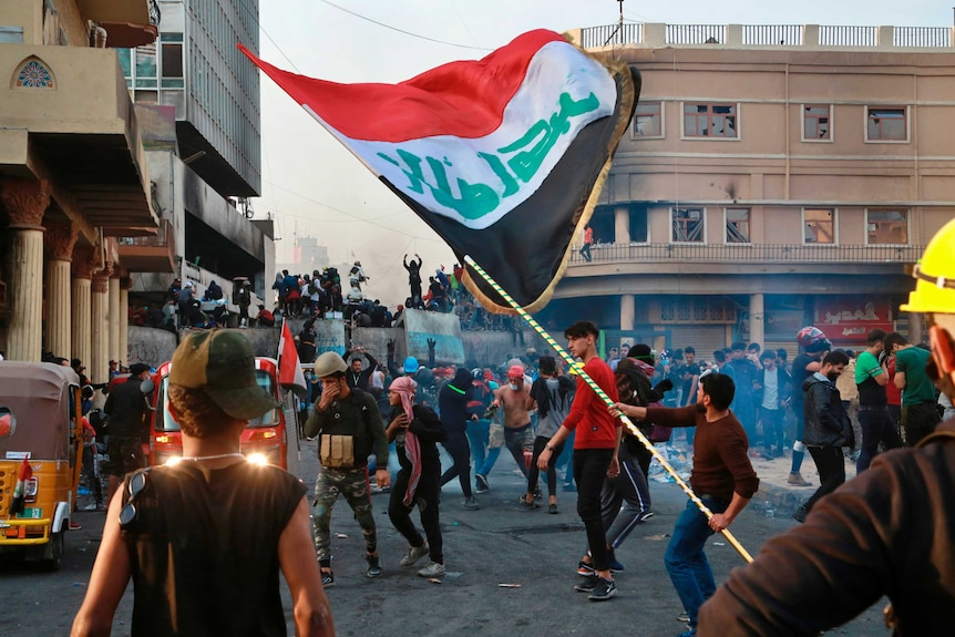 Anti-government protesters gather on Rasheed Street during clashes with security forces in Baghdad.