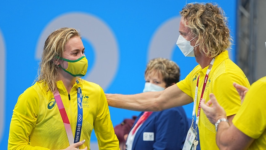 Ariarne titmus and Dean Boxall look at each other