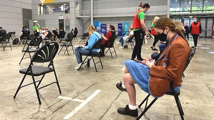 People waiting for vaccination at the Brisbane convention centre