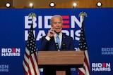 Joe Biden stands at a lectern
