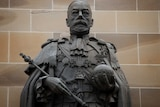 A bronze statue of King George V.
