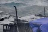 Asylum seekers float in rough surf