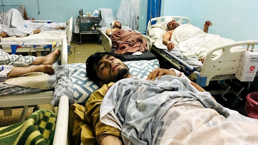 Victims lie wounded in a Kabul hospital after the attack