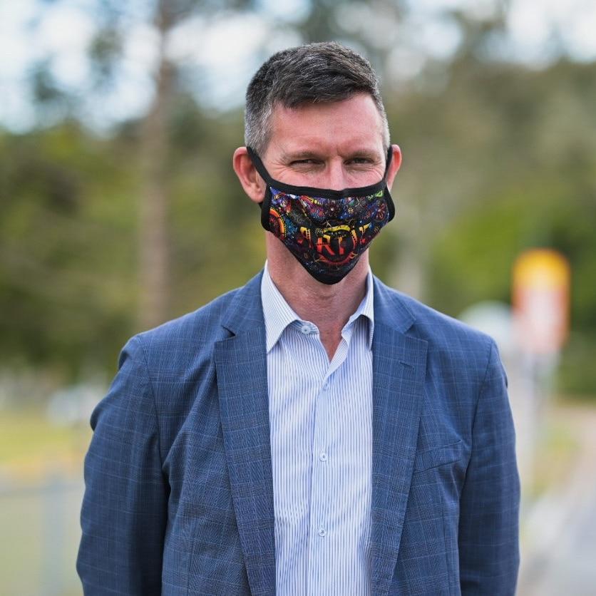 mark bailey in a face mask.