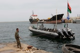 A member of the Libyan coast guard conducts a daily routine check.