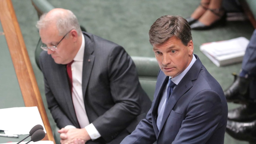 Angus Taylor speaks at the despatch box with Scott Morrison sitting behind him