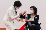 Tokyo governor receives Olympictorchlantern