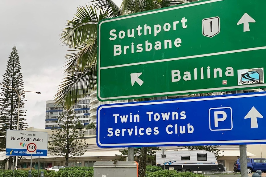 A road sign at the Queensland-New South Wales border on the Gold Coast