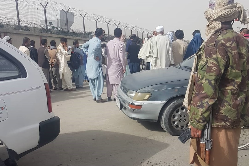 Photo appears to show Taliban militants near a checkpoint at Kabul Airport.