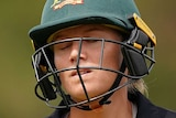 Alyssa Healy walks with her eyes closed and her shoulders slumped