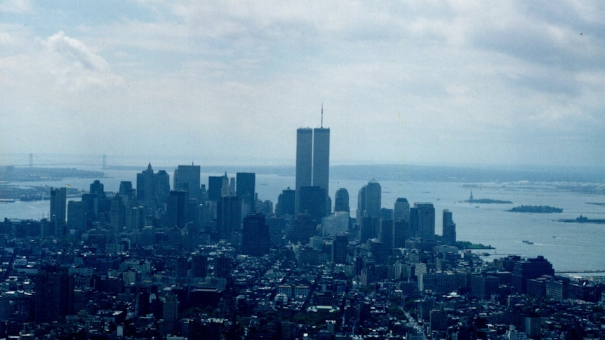 The Twin Towers stand tall over the New York skyline on a hazy day.