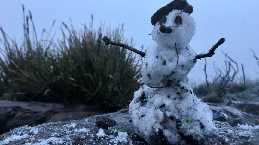 It may be small but it's still a snowman, built by hikers on Bluff Knoll.