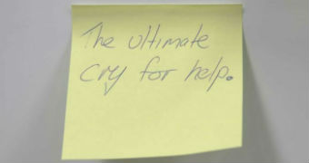 """Yellow posit with the words """"the ultimate cry for help"""" written on it."""