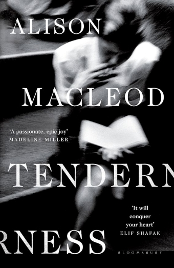 The book cover of Tenderness by Alison MacLeod with a blurry black and white image of a woman smoking and reading a book