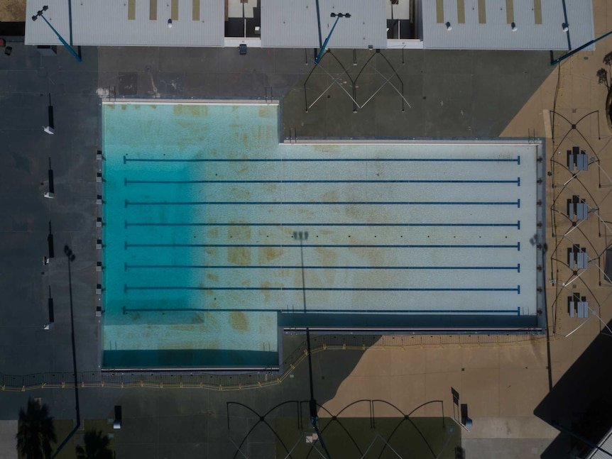 A drone image looks down on the outdoor pool where cleaning tracks can be seen on the pool floor